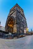 Tower on Charles Bridge in Prague early in the morning at sunris Stock Image