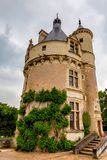 Tower of Chateau de Chenonceau on cloudy day. Beautiful medieval tower of Chateau de Chenonceau in Franceon cloudy day stock photo