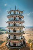 Tower with CHinese style at Wat Tham Suea or Tham Suea temple in Kanchanaburi, Thailand. stock photo