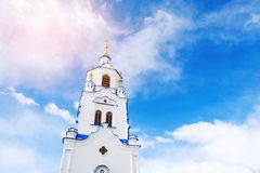 The tower of Church on background of blue sky with clouds. Russia, Tyumen.  royalty free stock photography