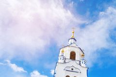 The tower of Church on background of blue sky with clouds. Russia, Tyumen.  royalty free stock images
