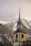 Tower of the church of Chamonix village in winter, France. Royalty Free Stock Photo