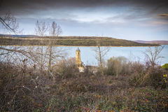 Tower church dams river Ebro Cantabria Spain. Church fallen in the river Ebro to his step along Cantabria Reinosa royalty free stock images