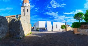 Tower of the Church of Lady of Health, Romanesque cathedral, basilica at the Square of The Glagolitic and school building of moder. N design municipality city royalty free stock photo