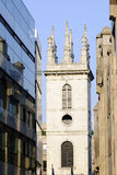 Tower of church and new buildings Royalty Free Stock Image