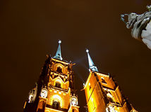 Tower church and sculpture. Towers of the Wroclaw cathedral at night royalty free stock photography