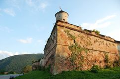 Citadel of The Guard, Brasov. Tower of Citadel of The Guard in Brasov, Romania, with mountains behind royalty free stock images