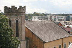 Tower in the city. Cork city tower, above roofs Royalty Free Stock Images