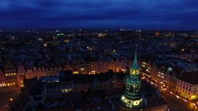 Tower of City Hall in Wroclaw. Aerial: Tower of City Hall in Wroclaw at night stock video footage