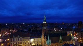 Tower of City Hall in Wroclaw. Aerial: Tower of City Hall in Wroclaw at night stock video