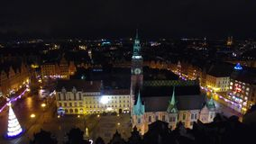 Tower of City Hall in Wroclaw. Aerial: Tower of City Hall in Wroclaw at night stock footage