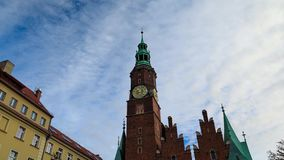 Tower of City Hall in Wroclaw. Timelapse: Tower of City Hall in Wroclaw, Poland stock video