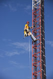 Tower climber ascending the guyed tower Stock Images