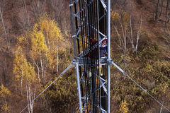 Tower climber inside the guyed tower Royalty Free Stock Photos
