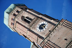 Tower with clock. One of two munich's frauenkirche towers royalty free stock image