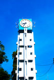 Tower clock on the blue sky. Background Royalty Free Stock Photos