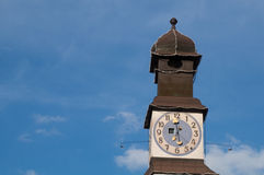 Tower with clock. On blue sky background Royalty Free Stock Photo