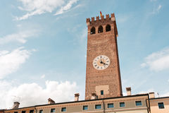 Tower with clock. Civic tower of the city of Bassano del Grappa, City located northeast of Italy Royalty Free Stock Images