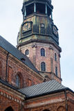 Tower clock of the famous St. Peter Church, Old town, Riga, Latvia Stock Photography