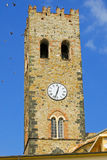 Tower clock. Medieval castle tower with clock in Italy Stock Image