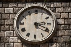 Tower clock with roman numerals. Wall clock with Roman numerals Royalty Free Stock Image