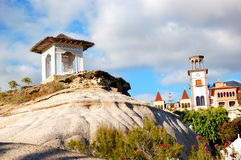 Tower with clock and sea view hut at the luxury hotel Stock Images