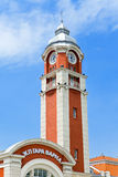 Tower with a  clock on a station building. Varna. Bulgaria. Landscape in a sunny day Royalty Free Stock Image