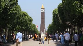 Tower clock in Tunis, Tunisia. TUNISIA, TUNIS, JUNE 30, 2010: People on avenue near tower clock in Tunis, Tunisia, June 30, 2010 stock video