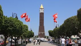 Tower clock in Tunis, Tunisia. TUNISIA, TUNIS, JUNE 30, 2010: People on avenue near tower clock in Tunis, Tunisia, June 30, 2010 stock video footage