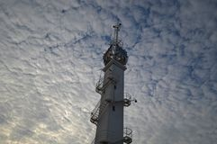 Tower on a cloudy sky royalty free stock photography