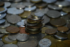 Tower of coins of different countries Stock Photography
