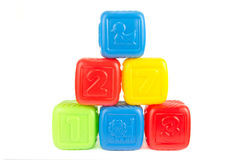 Tower of colourful plastic building blocks Stock Photos