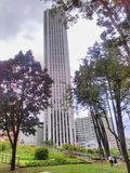 Tower Colpatria. The tallest tower in the city, seen from a park Royalty Free Stock Images