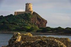 Tower Coltellazzo of Saint Efisio lighthouse at Nora, Sardinia, Italy Royalty Free Stock Photos