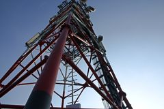 Tower with communications equipment. Tower covered in communications equipment and antennas Royalty Free Stock Photo