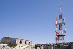 Tower of communications with their antennas. Red and white tower of communications with their telecommunications antennas Stock Photo