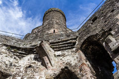 Tower in Conwy Castle, North Wales. An image taken from inside Conwy Castle walls looking up to one of the towers, with rails around the walkway Stock Photography