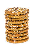 Tower from cookies with sesame seeds isolated on white Stock Photos