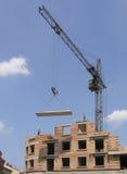 Tower crane. Lifts concrete block Stock Images
