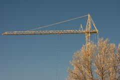 The tower crane. Covered with powerful hoarfrost against the dark blue sky Stock Photography