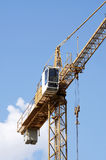 Tower crane. Is working at the buildig Stock Image
