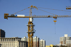 Tower crane. S stand in front of the buildings Stock Image