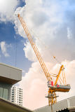 Tower crane above the roof royalty free stock photography