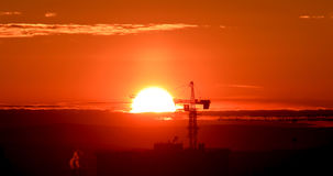 Tower crane against the backdrop of the setting sun. Backlight. Ekaterinburg, Russia Royalty Free Stock Photography