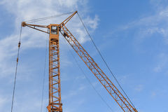 Tower crane against the blue sky Stock Image