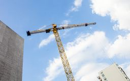 Tower crane against the cloudy sky Royalty Free Stock Photography