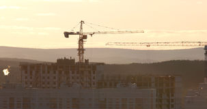 Tower crane against the sky in the afternoon. Ekaterinburg, Russia Stock Photo