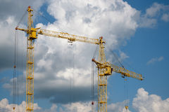 Tower crane on a background of clouds stock photo