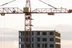 Construction crane near the building under construction. stock images