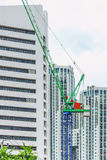Tower crane with background high-rise building Stock Photos